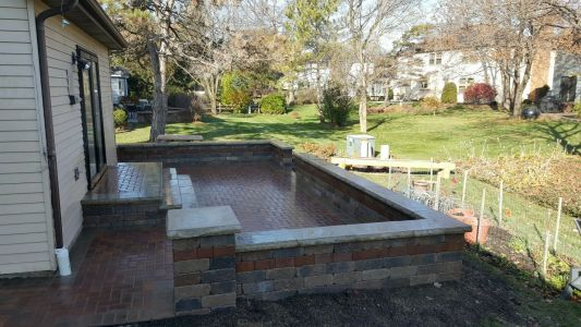 Brick patio in North Chicago Hillside Area by Brick Pavers