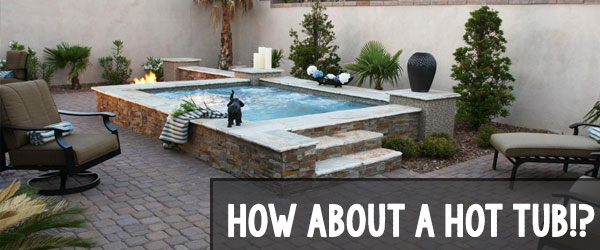 hot tub with brick paving patio